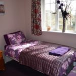 Bedroom 5 2 singles with wash basin in room