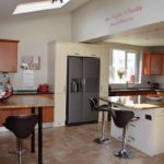 Large island kitchen. 5 ring hob, 2 separate full ovens, American fridge freezer with ice and chilled filtered water, dishwasher and microwave