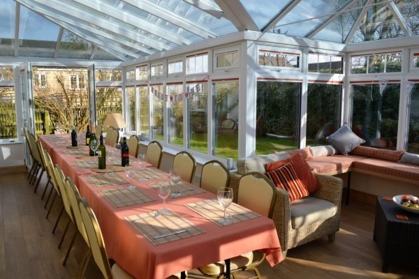 Lovely seating for large groups in dining conservatory