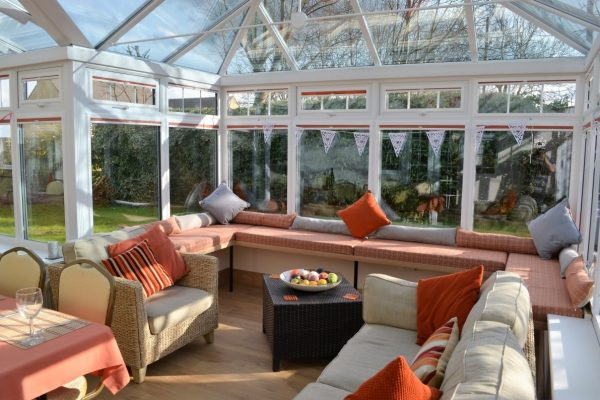 Flexible space in conservatory gives dining or activity plus seating space for up to 14